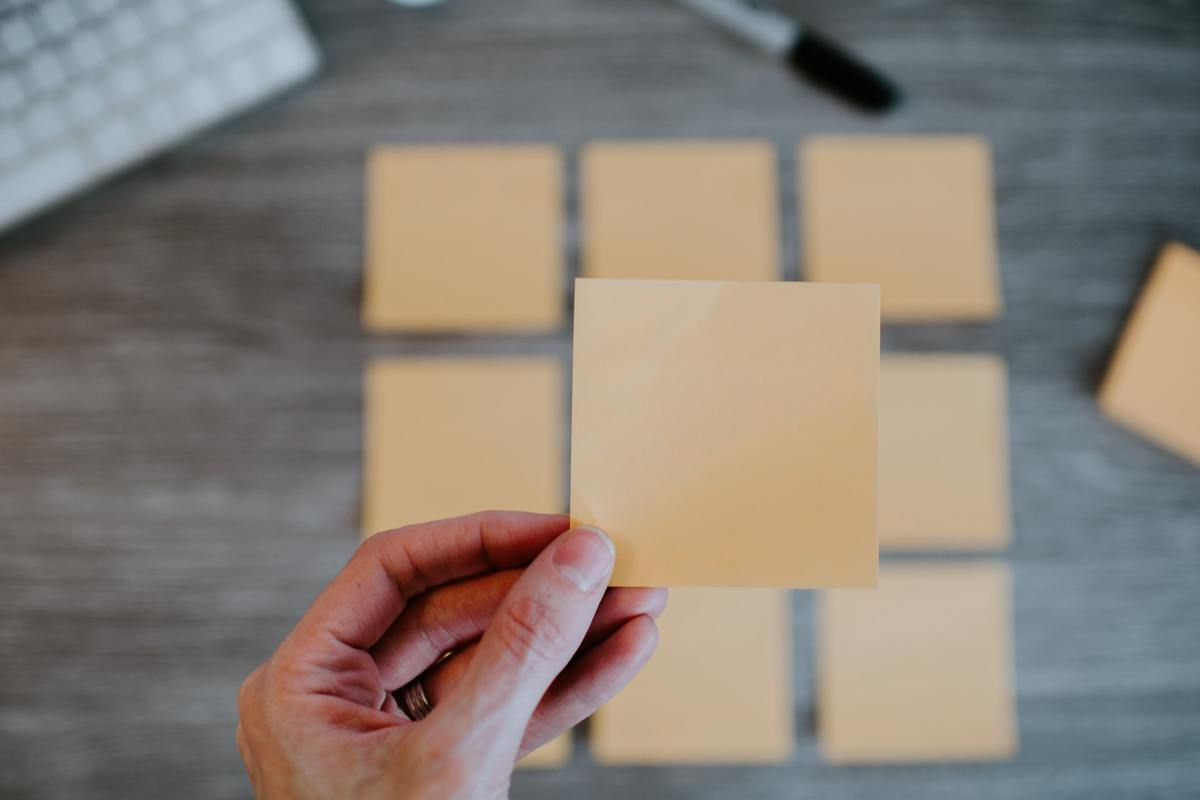 Person holding sticky note