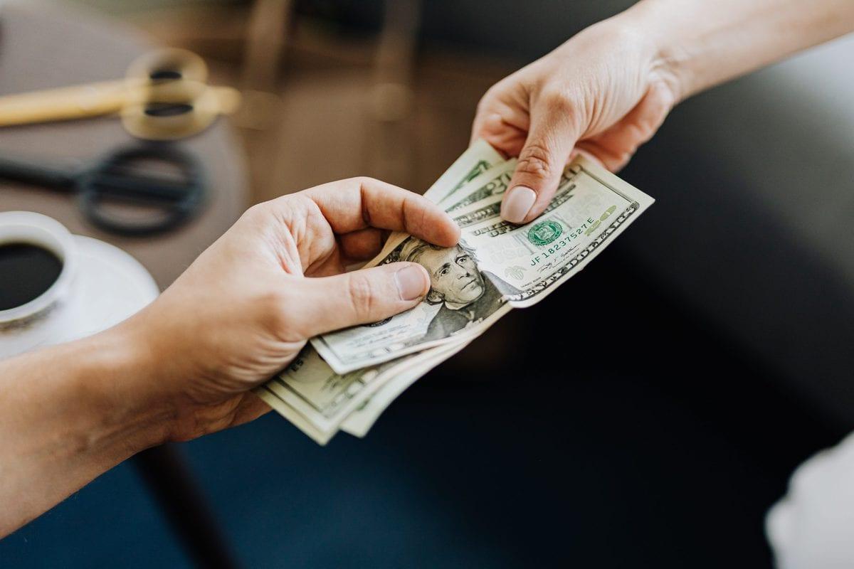 handing money hand to hand